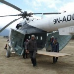 Building materials being unloaded from helicoptor at Syangboche airport